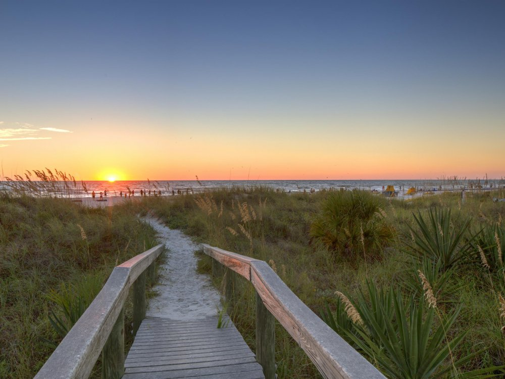 A walkway to Indian Rocks Beach at Sunset